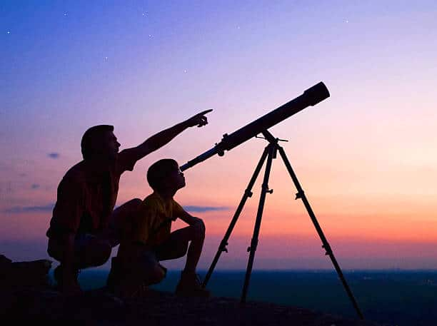 parent and kid stargazing